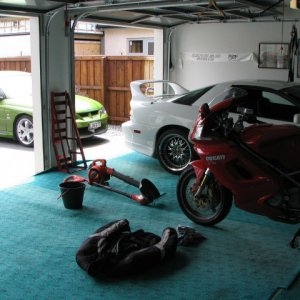View of my garage showing my V twin Ducati my Camaro and my HSV Maloo